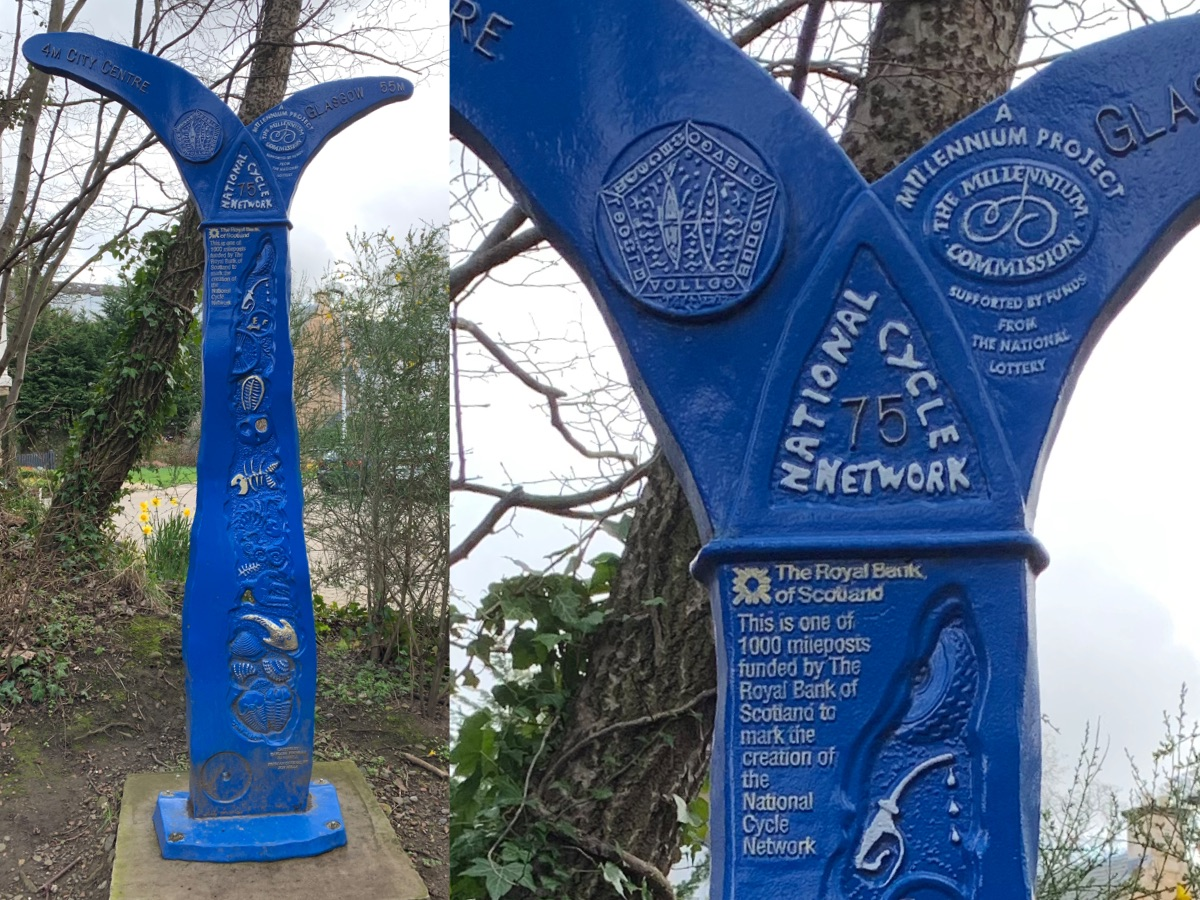 """The mills milepost in Colinton. The milepost says """"National Cycle Network 75"""", with the left side labelled """"4 Miles City Centre"""", the right """"55 Miles Glasgow"""". Additional text on the milepost describes the millennium milepost project."""