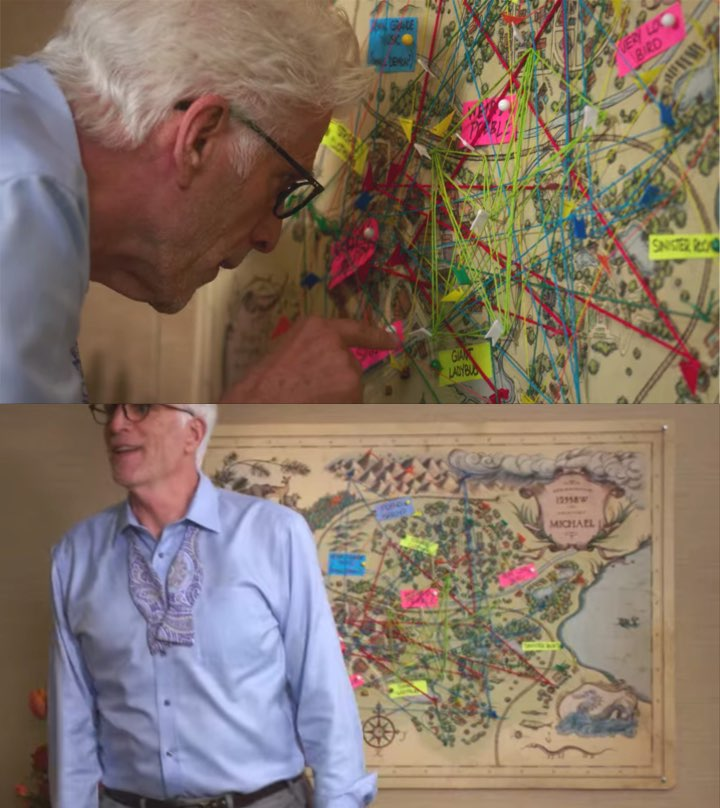 Two screenshots that feature a map in a background shot. One is a close up where Michael is pointing around on the map. The second is Michael standing in front of the map, obscuring a lot of the details.