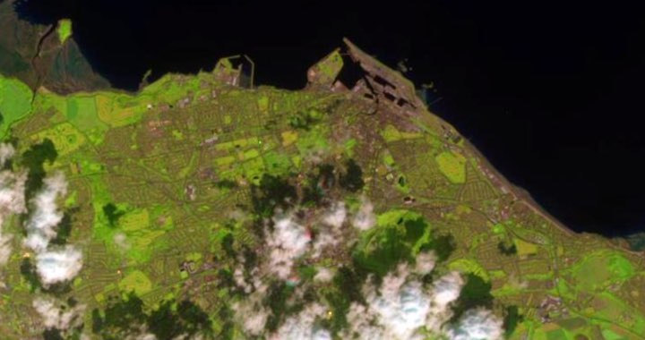 Satellite imagery of Edinburgh from the Sentinel-2 Satellite. The image shows clouds covering up parts of Edinburgh and the details of the city are very hard to make out.